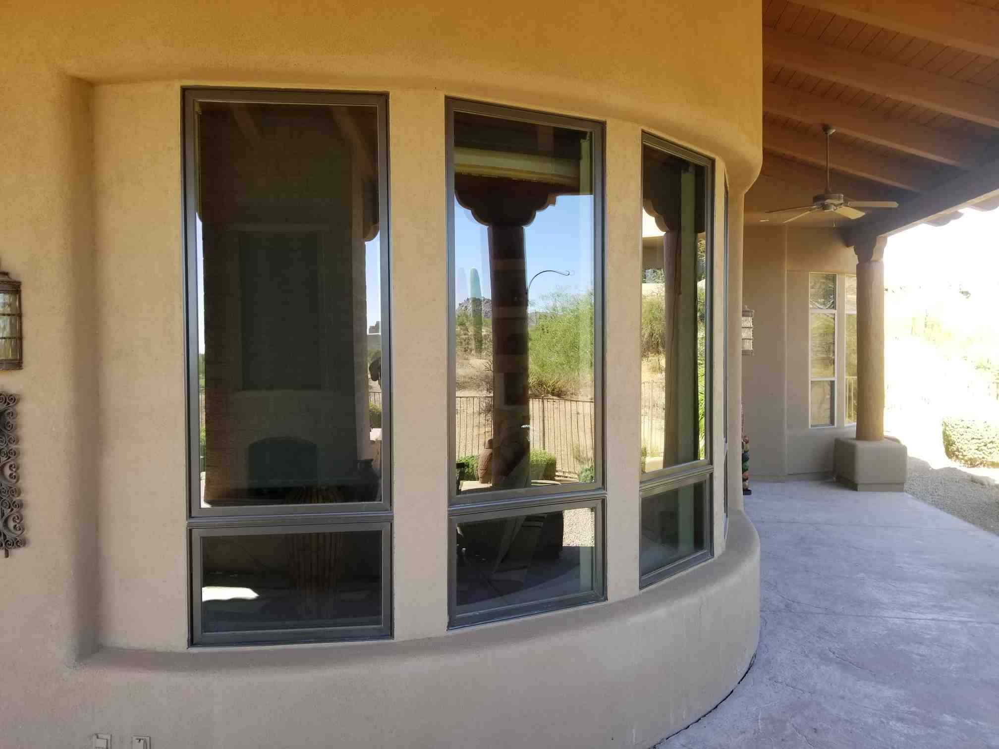 Arizona Window and Door in Scottsdale and Tucson showing wood windows on curve of house